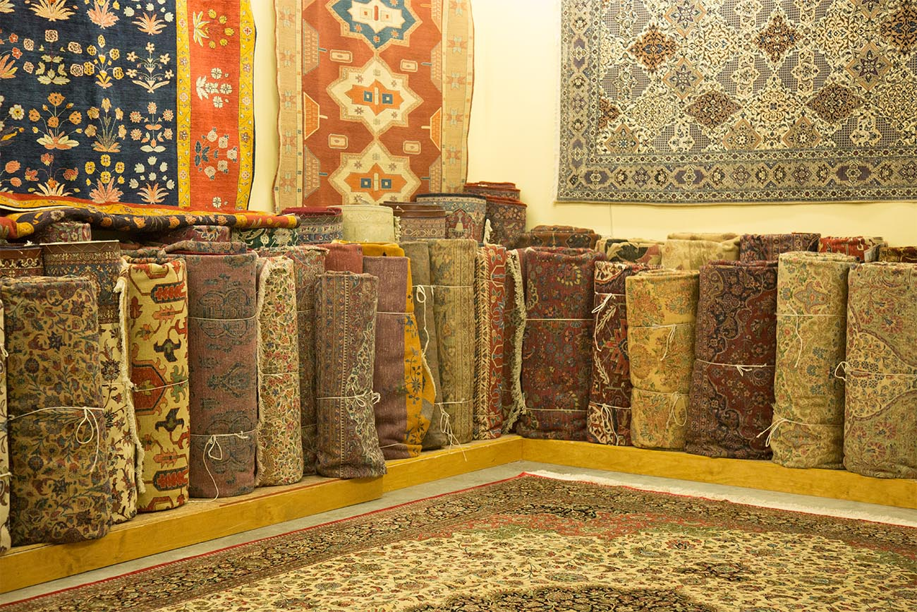 Image of wall of rugs for sale in Minneapolis